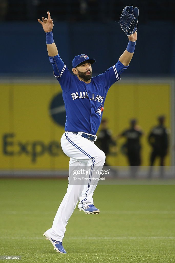 Jose Bautista of the Toronto Blue Jays celebrates defeating the Kansas City Royals 71 in game five of the American League Championship Series at...