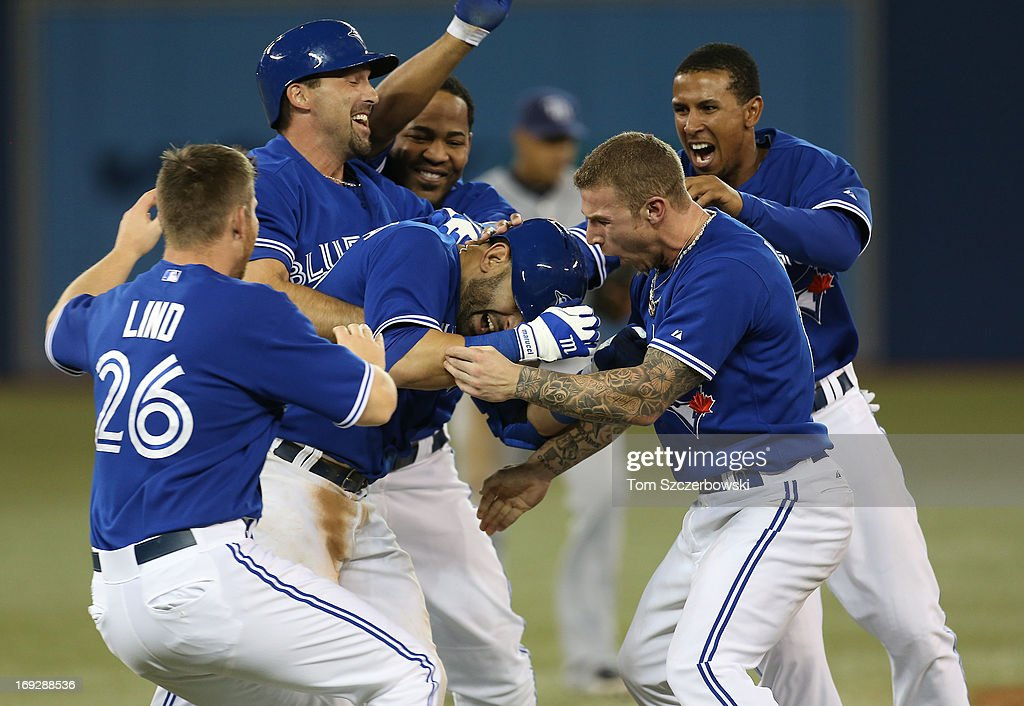 Jose Bautista #19 of the Toronto Blue Jays celebrates his game-winning hit in the tenth inning with <a gi-track='captionPersonalityLinkClicked' href=/galleries/search?phrase=Brett+Lawrie&family=editorial&specificpeople=5496694 ng-click='$event.stopPropagation()'>Brett Lawrie</a> #13 during MLB game action against the Tampa Bay Rays on May 22, 2013 at Rogers Centre in Toronto, Ontario, Canada.