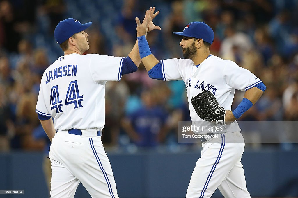 Jose Bautista #19 of the Toronto Blue Jays celebrates their victory with <a gi-track='captionPersonalityLinkClicked' href=/galleries/search?phrase=Casey+Janssen&family=editorial&specificpeople=598479 ng-click='$event.stopPropagation()'>Casey Janssen</a> #44 during MLB game action against the Baltimore Orioles on August 6, 2014 at Rogers Centre in Toronto, Ontario, Canada.