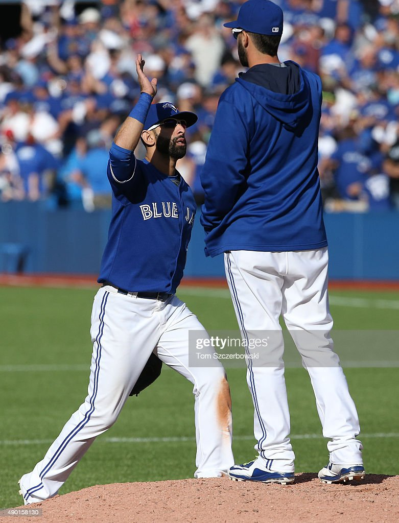 Jose Bautista #19 of the Toronto Blue Jays celebrates their victory with Chris Colabello #15 during MLB game action against the Tampa Bay Rays on September 26, 2015 at Rogers Centre in Toronto, Ontario, Canada.