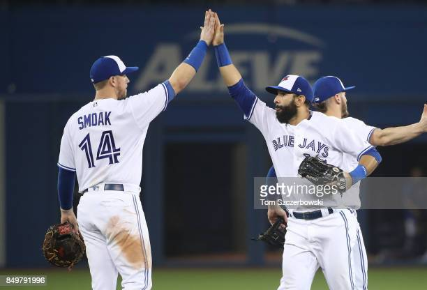 Jose Bautista of the Toronto Blue Jays celebrates their victory with Justin Smoak during MLB game action against the Kansas City Royals at Rogers...