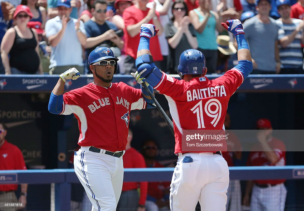 Jose Bautista #19 of the Toronto Blue Jays celebrates with <a gi-track='captionPersonalityLinkClicked' href=/galleries/search?phrase=Edwin+Encarnacion&family=editorial&specificpeople=598285 ng-click='$event.stopPropagation()'>Edwin Encarnacion</a> #10 after hitting a solo home run in the first inning during MLB game action against the Milwaukee Brewers on July 1, 2014 at Rogers Centre in Toronto, Ontario, Canada.