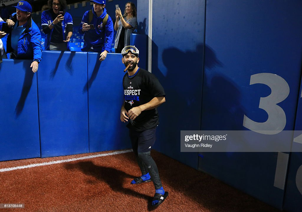 Jose Bautista #19 of the Toronto Blue Jays celebrates with fans after the Toronto Blue Jays defeated the Texas Rangers 7-6 for game three of the American League Division Series at Rogers Centre on October 9, 2016 in Toronto, Canada.