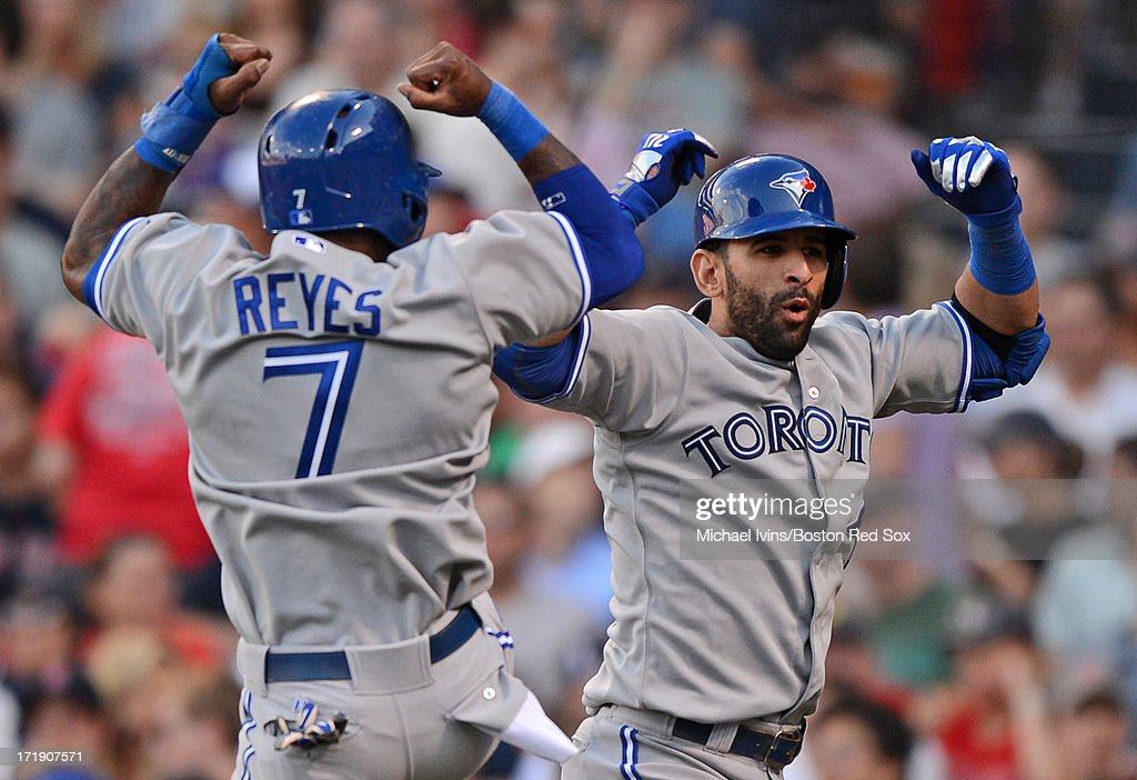 Jose Bautista #19 of the Toronto Blue Jays celebrates with Jose Reyes #7 after hitting a go ahead two-run home run against the Boston Red Sox in the eighth inning on June 29, 2013 at Fenway Park in Boston, Massachusetts.