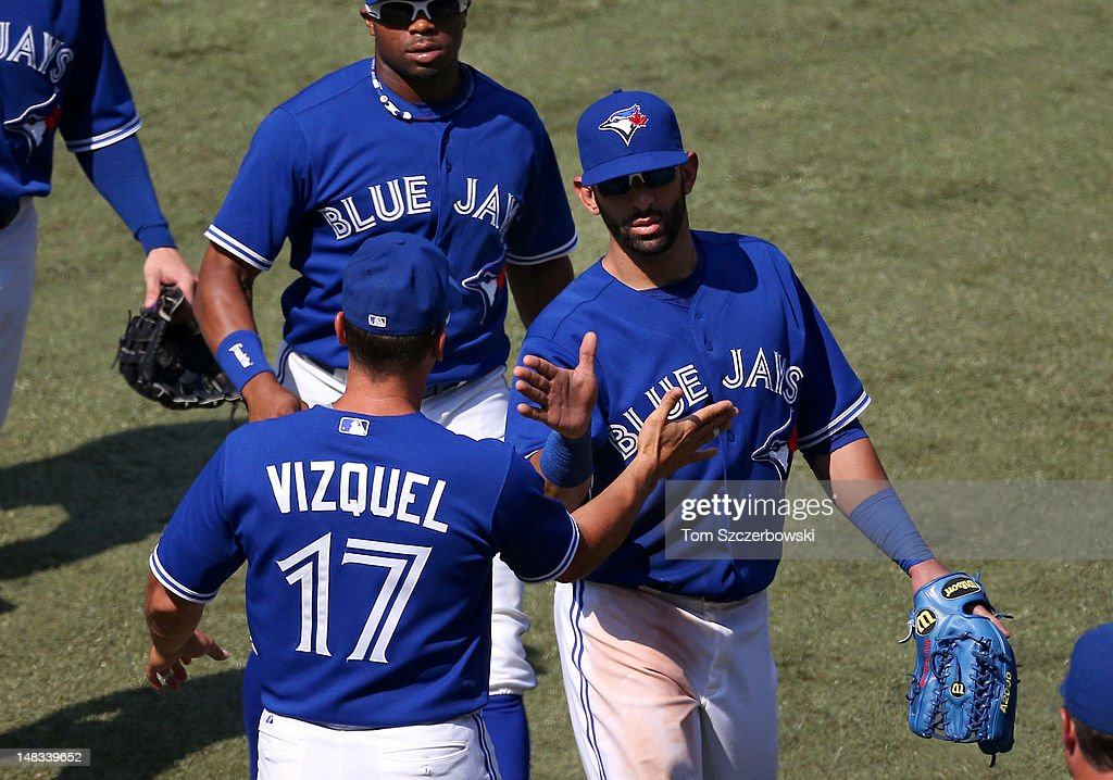 Jose Bautista #19 of the Toronto Blue Jays celebrates with <a gi-track='captionPersonalityLinkClicked' href=/galleries/search?phrase=Omar+Vizquel&family=editorial&specificpeople=201489 ng-click='$event.stopPropagation()'>Omar Vizquel</a> #17 and <a gi-track='captionPersonalityLinkClicked' href=/galleries/search?phrase=Rajai+Davis&family=editorial&specificpeople=810608 ng-click='$event.stopPropagation()'>Rajai Davis</a> #11 after their victory during MLB game action against the Cleveland Indians on July 14, 2012 at Rogers Centre in Toronto, Ontario, Canada.