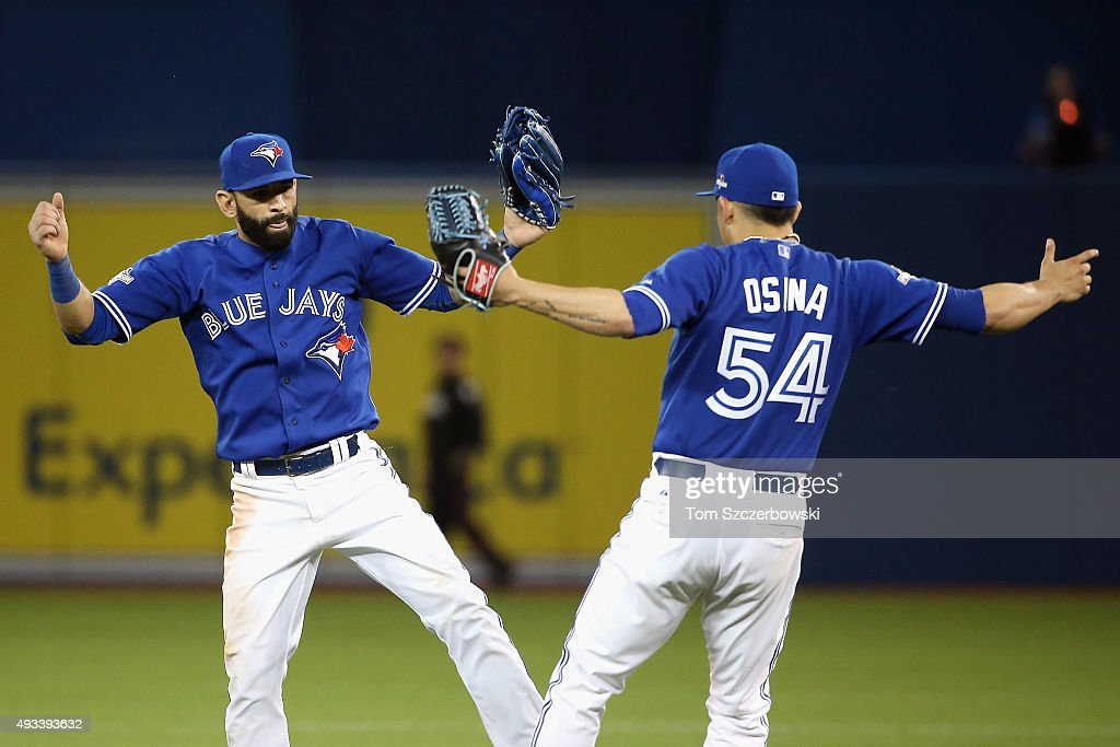 Jose Bautista #19 of the Toronto Blue Jays celebrates with Roberto Osuna #54 of the Toronto Blue Jays after defeating the Kansas City Royals 11-8 in game three of the American League Championship Series at Rogers Centre on October 19, 2015 in Toronto, Canada.