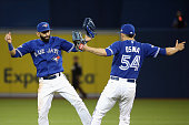 Jose Bautista of the Toronto Blue Jays celebrates with Roberto Osuna of the Toronto Blue Jays after defeating the Kansas City Royals 118 in game...