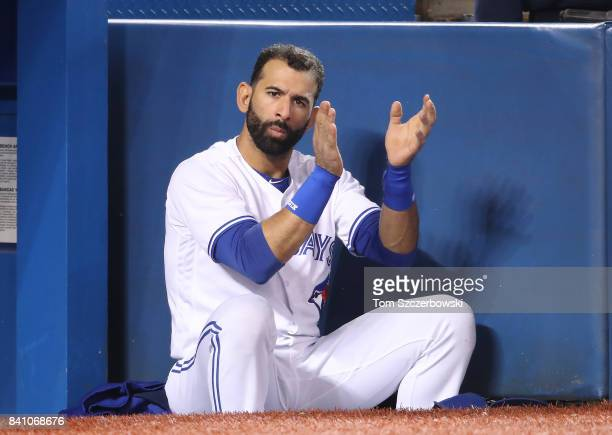 Jose Bautista of the Toronto Blue Jays cheers on a rally in the bottom of the eighth inning during MLB game action against the Boston Red Sox at...