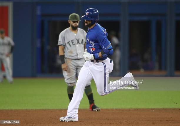 Jose Bautista of the Toronto Blue Jays circles the bases after hitting a threerun home run in the fifth inning during MLB game action as Rougned Odor...