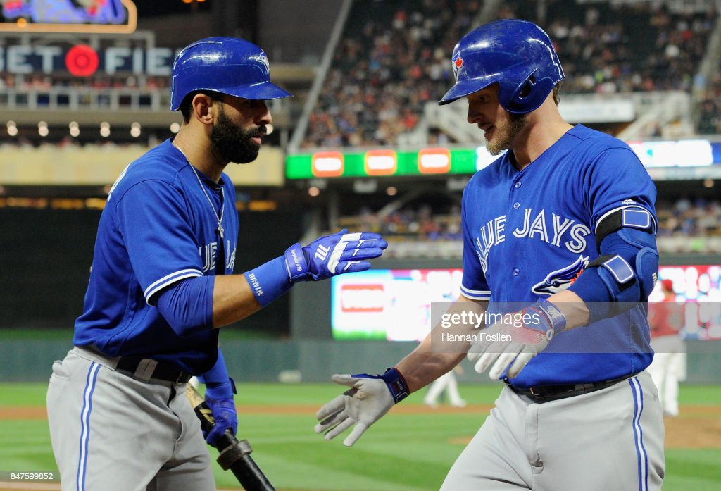 Jose Bautista #19 of the Toronto Blue Jays congratulates teammate Josh Donaldson #20 on a solo home run against the Minnesota Twins during the sixth inning of the game on September 15, 2017 at Target Field in Minneapolis, Minnesota.