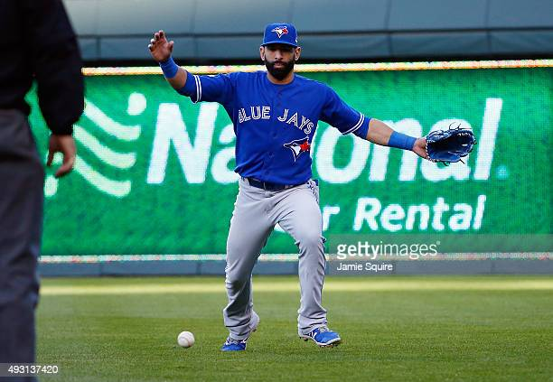 Jose Bautista of the Toronto Blue Jays fails to catch a ball hit by Ben Zobrist of the Kansas City Royals in the seventh inning in game two of the...