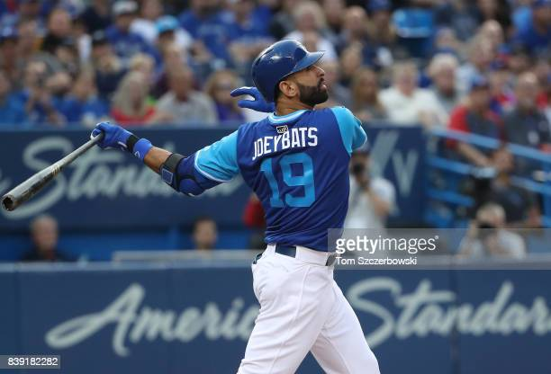 Jose Bautista of the Toronto Blue Jays flies out in the first inning during MLB game action against the Minnesota Twins at Rogers Centre on August 25...