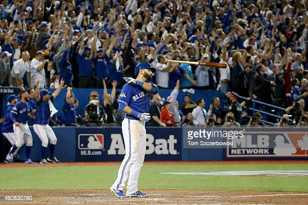 Jose Bautista of the Toronto Blue Jays flips his bat up in the air after he hits a threerun home run in the seventh inning against the Texas Rangers...
