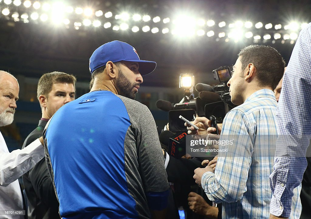 Jose Bautista #19 of the Toronto Blue Jays gives an interview before returning to the lineup prior to an MLB game against the New York Yankees on April 19, 2013 at Rogers Centre in Toronto, Ontario, Canada.