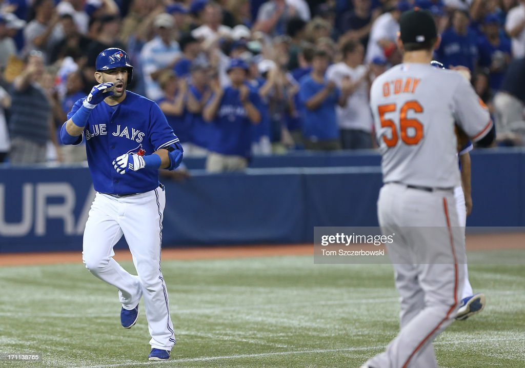Jose Bautista #19 of the Toronto Blue Jays has words for <a gi-track='captionPersonalityLinkClicked' href=/galleries/search?phrase=Darren+O%27Day&family=editorial&specificpeople=4921679 ng-click='$event.stopPropagation()'>Darren O'Day</a> #56 of the Baltimore Orioles after hitting a 2-run home run in the eighth inning during MLB game action against on June 22, 2013 at Rogers Centre in Toronto, Ontario, Canada.