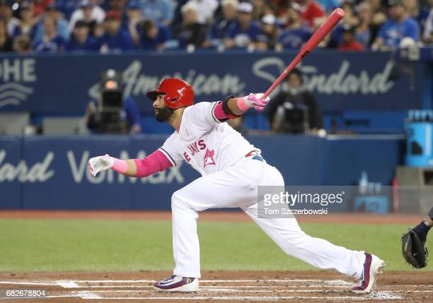 Jose Bautista of the Toronto Blue Jays hits a double in the first inning during MLB game action against the Seattle Mariners at Rogers Centre on May...