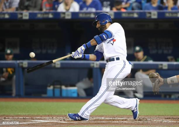 Jose Bautista of the Toronto Blue Jays hits a double in the first inning during MLB game action against the Oakland Athletics at Rogers Centre on...