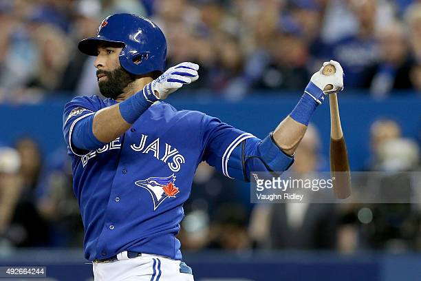 Jose Bautista of the Toronto Blue Jays hits a RBI double in the third inning against the Texas Rangers in game five of the American League Division...