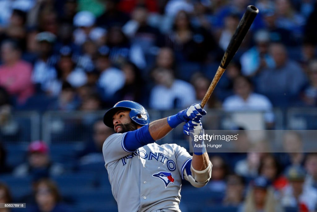 Jose Bautista #19 of the Toronto Blue Jays hits a sacrifice fly against the New York Yankees during the fourth inning at Yankee Stadium on October 1, 2017 in the Bronx borough of New York City.
