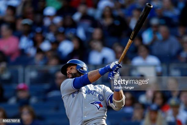 Jose Bautista of the Toronto Blue Jays hits a sacrifice fly against the New York Yankees during the fourth inning at Yankee Stadium on October 1 2017...