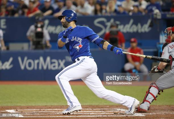 Jose Bautista of the Toronto Blue Jays hits a single in the first inning during MLB game action against the Cincinnati Reds at Rogers Centre on May...