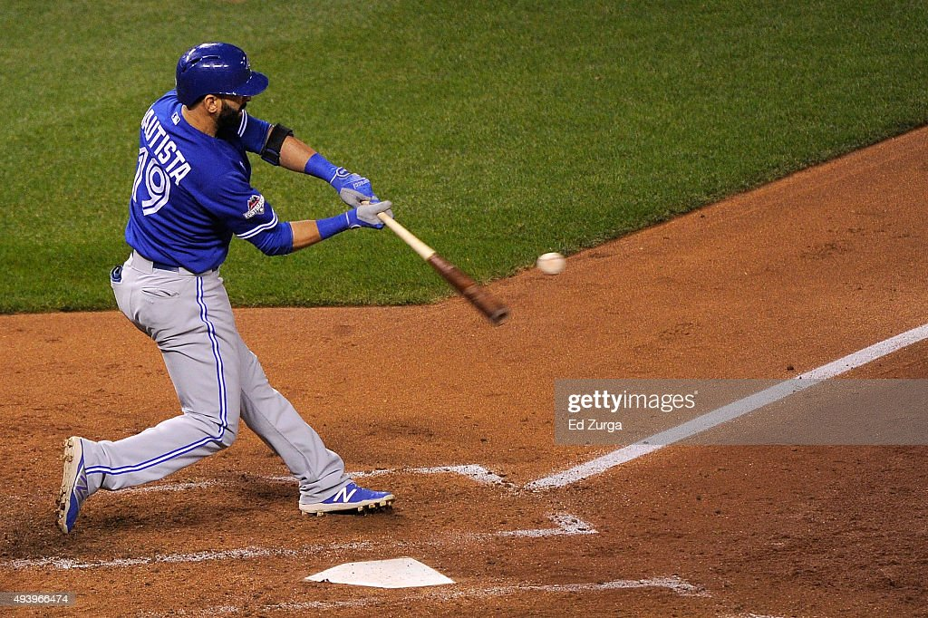 Jose Bautista of the Toronto Blue Jays hits a solo home run in the fourth inning against the Kansas City Royals in game six of the 2015 MLB American...