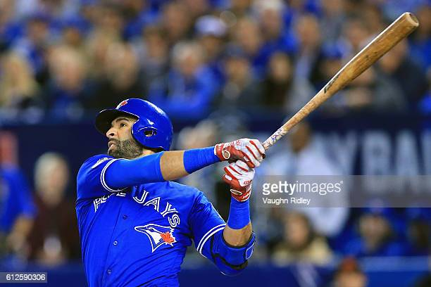 Jose Bautista of the Toronto Blue Jays hits a solo home run in the second inning against the Baltimore Orioles during the American League Wild Card...