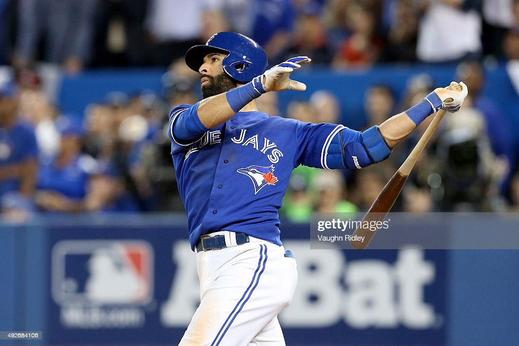 Jose Bautista #19 of the Toronto Blue Jays hits a three-run home run in the seventh inning against the Texas Rangers in game five of the American League Division Series at Rogers Centre on October 14, 2015 in Toronto, Canada.