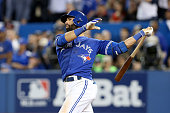 Jose Bautista of the Toronto Blue Jays hits a threerun home run in the seventh inning against the Texas Rangers in game five of the American League...