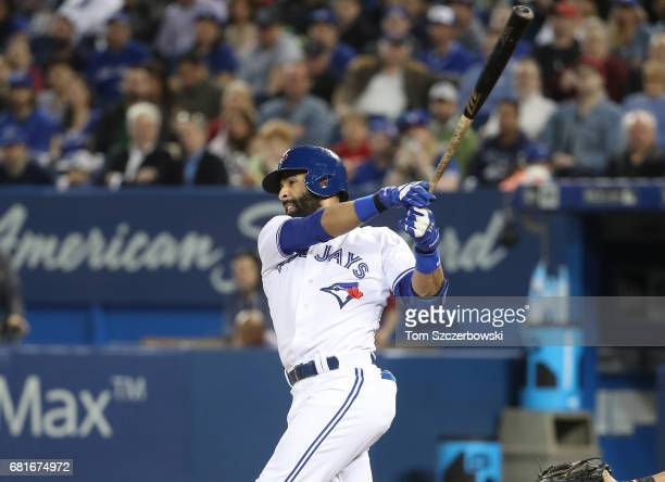 Jose Bautista of the Toronto Blue Jays hits a threerun home run in the first inning during MLB game action against the Cleveland Indians at Rogers...