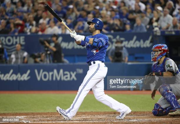 Jose Bautista of the Toronto Blue Jays hits a threerun home run in the fifth inning during MLB game action against the Texas Rangers at Rogers Centre...