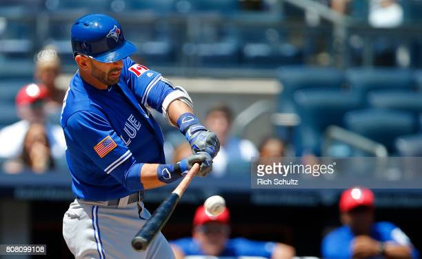 Jose Bautista of the Toronto Blue Jays hits an RBI single during the third inning of a game against the New York Yankees at Yankee Stadium on July 4...