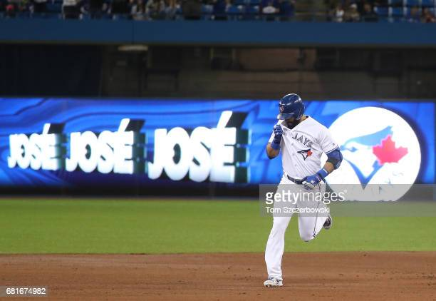 Jose Bautista of the Toronto Blue Jays is circles the bases after hitting a threerun home run in the first inning during MLB game action against the...