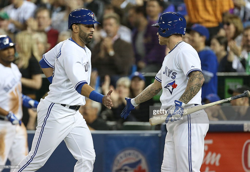Jose Bautista #19 of the Toronto Blue Jays is congratulated by <a gi-track='captionPersonalityLinkClicked' href=/galleries/search?phrase=Brett+Lawrie&family=editorial&specificpeople=5496694 ng-click='$event.stopPropagation()'>Brett Lawrie</a> #13 after scoring a run in the first inning during MLB game action against the San Francisco Giants on May 14, 2013 at Rogers Centre in Toronto, Ontario, Canada.