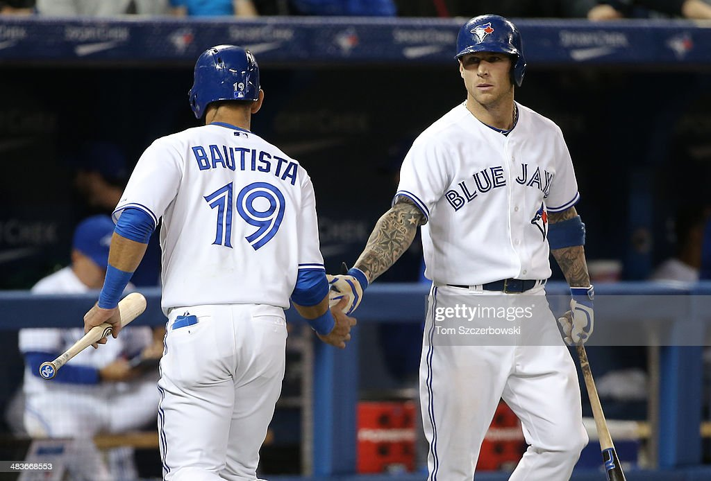 Jose Bautista #19 of the Toronto Blue Jays is congratulated by <a gi-track='captionPersonalityLinkClicked' href=/galleries/search?phrase=Brett+Lawrie&family=editorial&specificpeople=5496694 ng-click='$event.stopPropagation()'>Brett Lawrie</a> #13 after scoring a run in the fifth inning during MLB game action against the Houston Astros on April 9, 2014 at Rogers Centre in Toronto, Ontario, Canada.