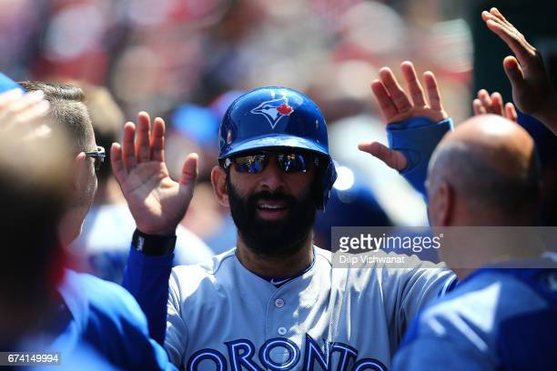Jose Bautista of the Toronto Blue Jays is congratulated by his teammates after scoring a run against the St Louis Cardinals in the sixth inning at...