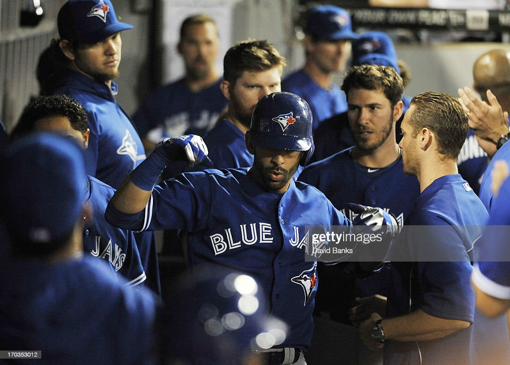 Jose Bautista #19 of the Toronto Blue Jays is greeted by his teammates after hitting a game tying home run during the ninth inning against the Chicago White Sox on June 11, 2013 at U.S. Cellular Field in Chicago, Illinois.