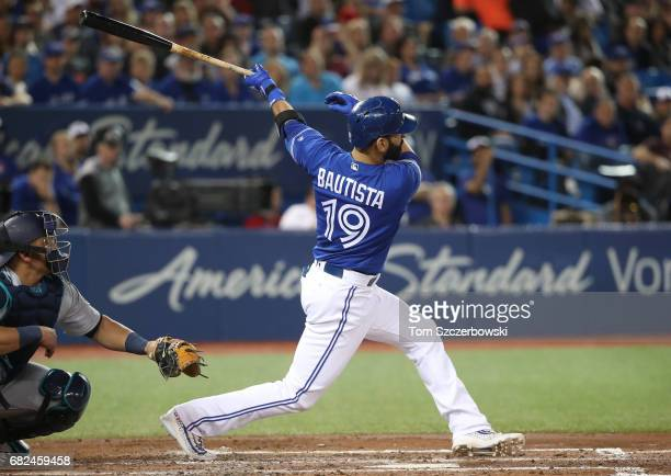 Jose Bautista of the Toronto Blue Jays is hits a tworun home run in the third inning during MLB game action against the Seattle Mariners at Rogers...