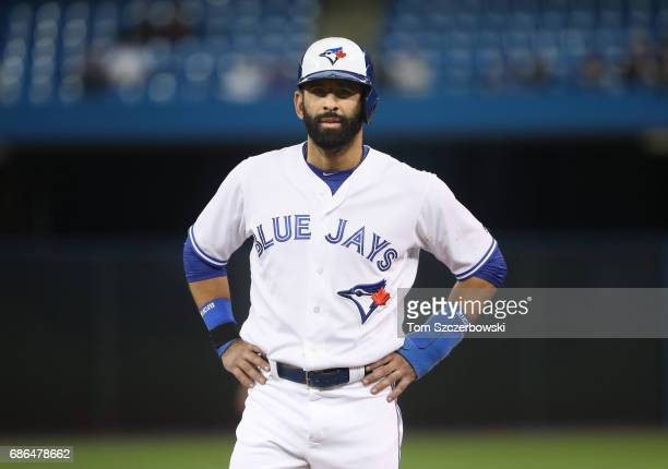 Jose Bautista of the Toronto Blue Jays looks on from first base in the ninth inning during MLB game action against the Atlanta Braves at Rogers...