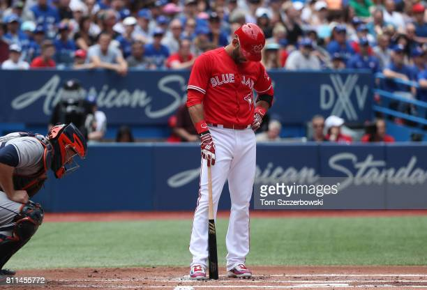 Jose Bautista of the Toronto Blue Jays reacts after being called out on strikes in the first inning during MLB game action against the Houston Astros...