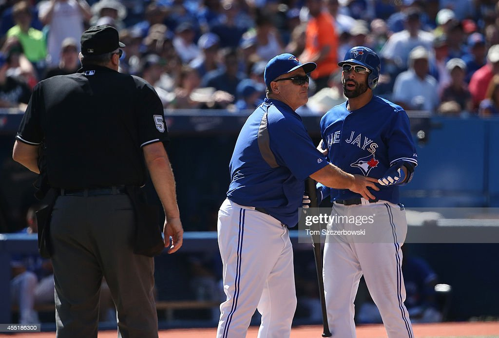 Jose Bautista #19 of the Toronto Blue Jays reacts after being ejected by home plate umpire Bill Welke #52 for arguing a called third strike as manager <a gi-track='captionPersonalityLinkClicked' href=/galleries/search?phrase=John+Gibbons&family=editorial&specificpeople=218120 ng-click='$event.stopPropagation()'>John Gibbons</a> #5 comes out to restrain him in the sixth inning during MLB game action against the Tampa Bay Rays on August 24, 2014 at Rogers Centre in Toronto, Ontario, Canada.