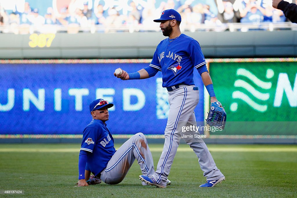 Jose Bautista of the Toronto Blue Jays reacts after failing to catch a ball hit by Ben Zobrist of the Kansas City Royals in the seventh inning in...