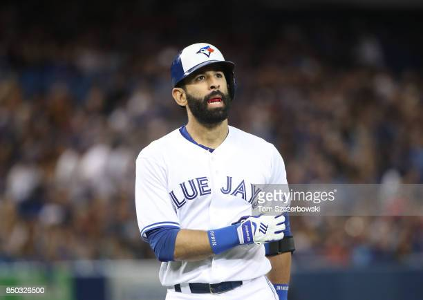 Jose Bautista of the Toronto Blue Jays reacts after lining out in the second inning during MLB game action against the Kansas City Royals at Rogers...