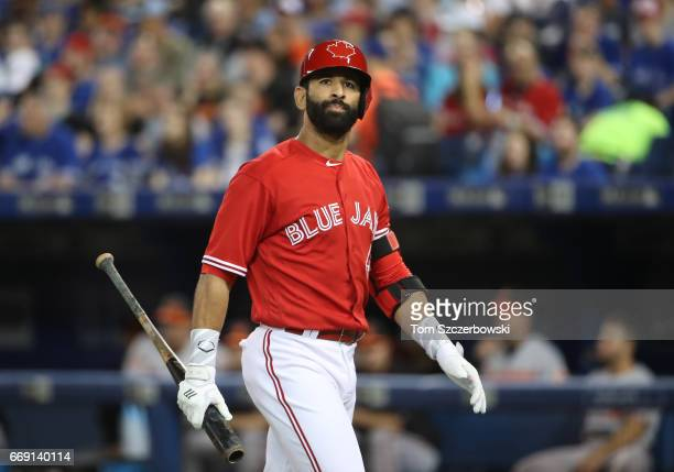 Jose Bautista of the Toronto Blue Jays reacts after striking out in the first inning during MLB game action against the Baltimore Orioles at Rogers...