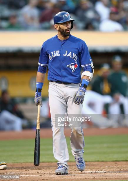 Jose Bautista of the Toronto Blue Jays reacts after striking out in the third inning against the Oakland Athletics at Oakland Alameda Coliseum on...