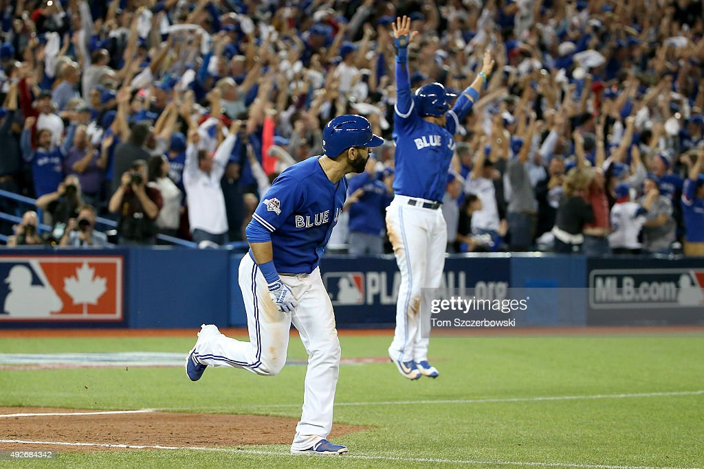Jose Bautista #19 of the Toronto Blue Jays rounds the bases after he hits a three-run home run in the seventh inning against the Texas Rangers in game five of the American League Division Series at Rogers Centre on October 14, 2015 in Toronto, Canada.