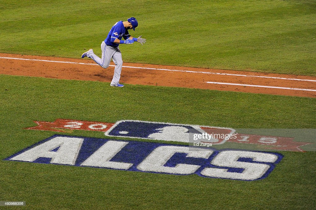 Jose Bautista of the Toronto Blue Jays rounds the bases after he hits a tworun home run in the eighth inning against the Kansas City Royals in game...