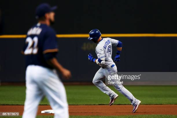 Jose Bautista of the Toronto Blue Jays rounds the bases after hitting a home run off of Matt Garza of the Milwaukee Brewers in the fourth inning at...