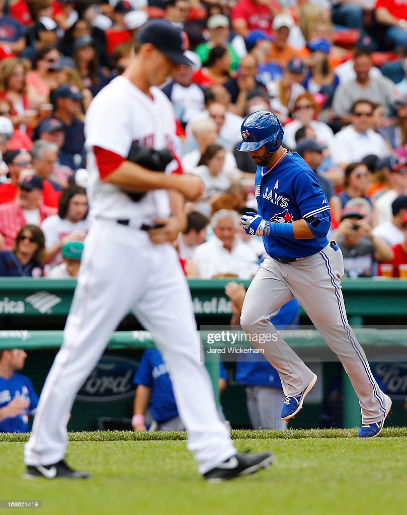 Jose Bautista #19 of the Toronto Blue Jays rounds third base after hitting a two-run home run in the sixth inning against the Boston Red Sox during the game on May 12, 2013 at Fenway Park in Boston, Massachusetts.
