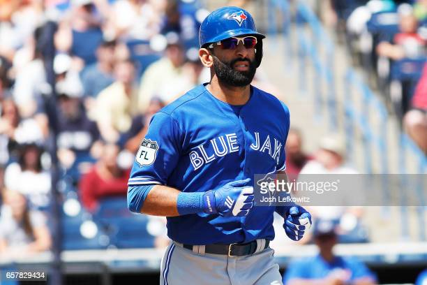 Jose Bautista of the Toronto Blue Jays runs to first base after a walk during the game between the Toronto Blue Jays and the New York Yankees at...